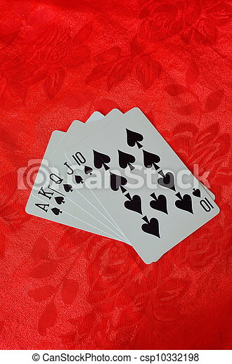 cards on red felt poker table - csp10332198