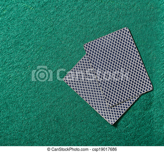cards on the green poker table - csp19017686