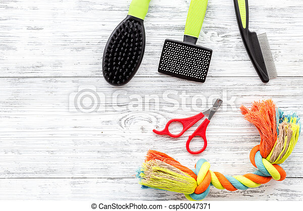 care about pet with brushes and toys grooming equipment on white wooden table background top view mockup