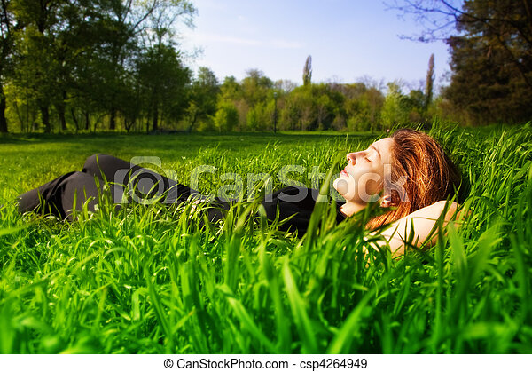 Carefree concept - woman relaxing outdoor in grass - csp4264949
