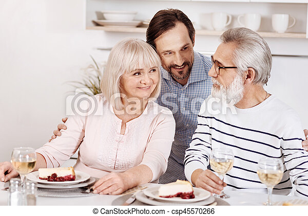 Careful mature son enjoying family dinner with parents at home - csp45570266