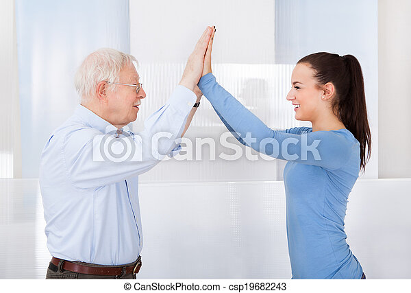 Caregiver And Senior Man Giving High Five - csp19682243