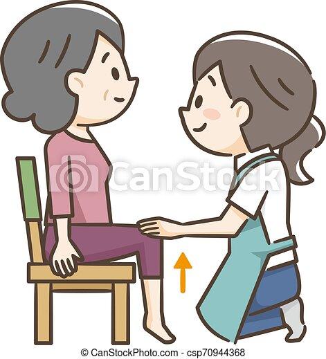Una anciana sentada en una silla con un cuidador - csp70944368