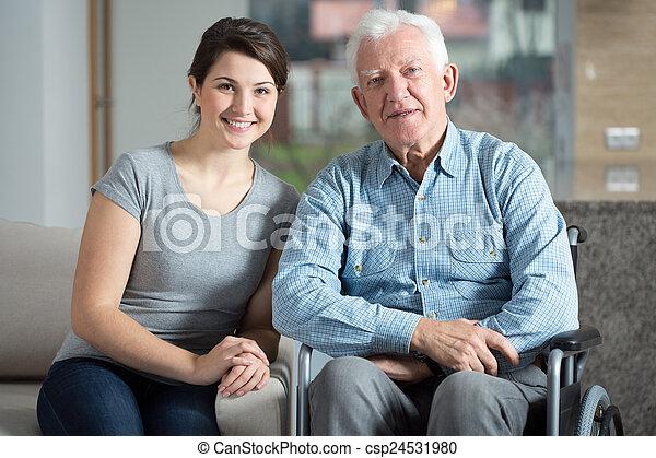 Caretaker and elderly man - csp24531980