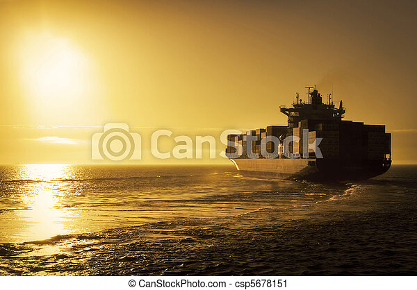 Cargo container ship in sunset - csp5678151