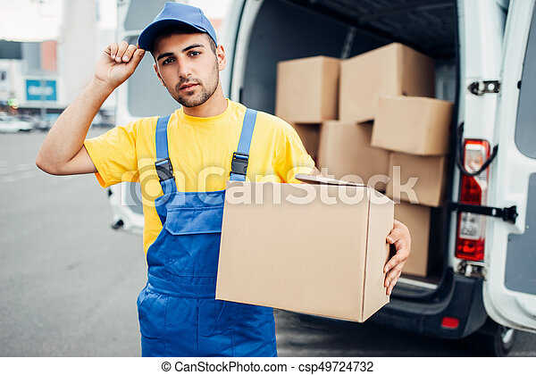 Cargo delivery, male courier with box in hand  Cargo