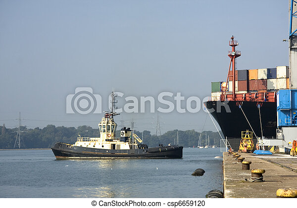 Cargo ship emerges from dock - csp6659120
