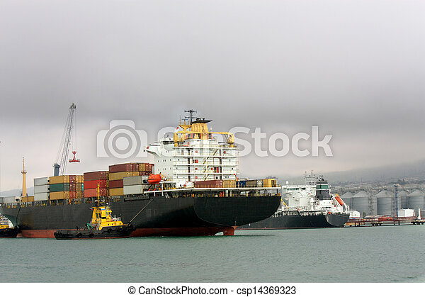 Cargo vessel at an entrance to seaport - csp14369323