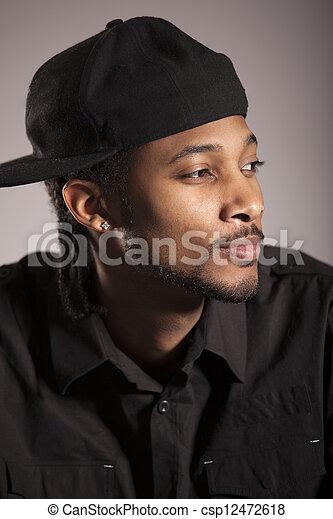 Caribbean man portrait in studio - csp12472618