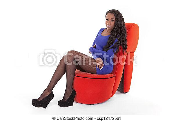 Caribbean woman sitting in studio - csp12472561