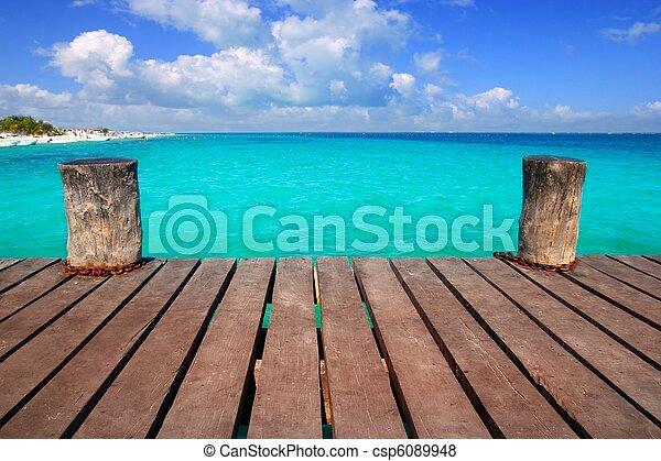 Caribbean wood pier with turquoise aqua sea - csp6089948
