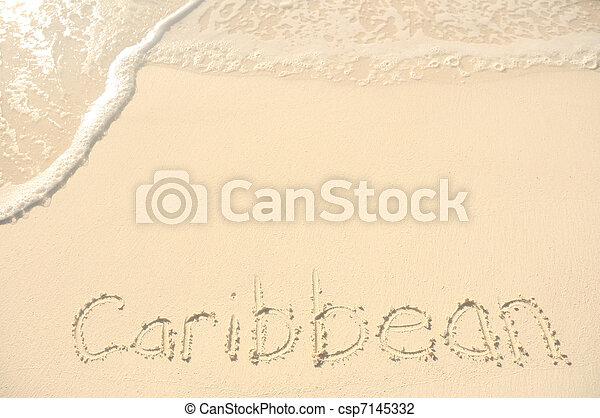 Caribbean Written in Sand on Beach - csp7145332