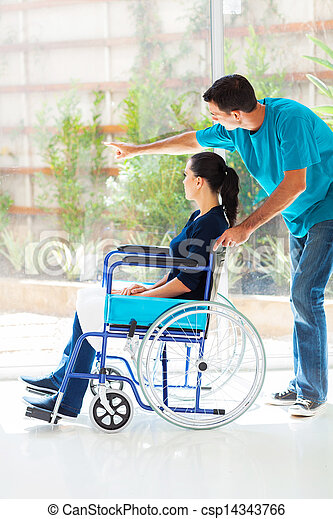 caring husband and disabled wife looking outside window - csp14343766