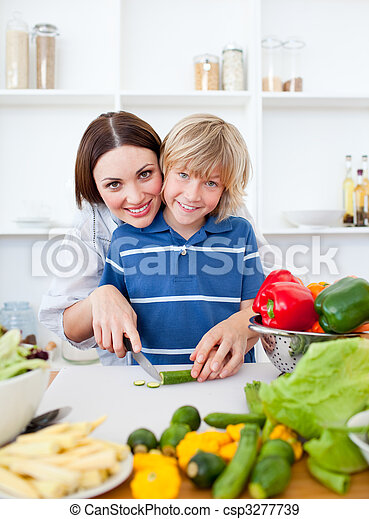 Caring mother and her son cooking  - csp3277739
