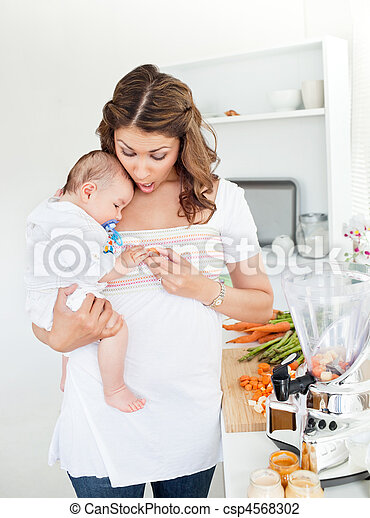 Caring mother preparing food - csp4568302