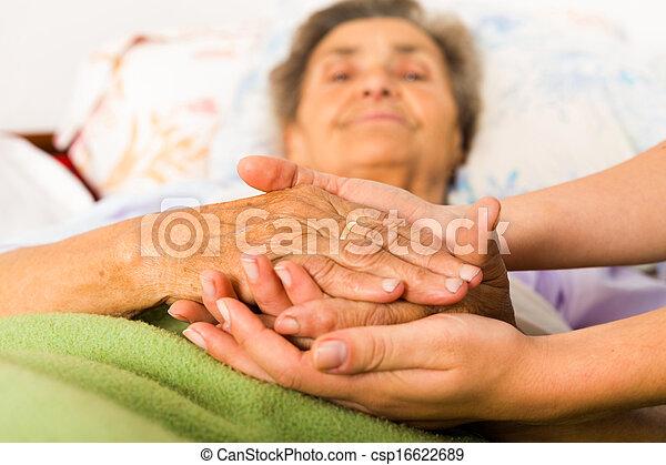 Caring Nurse Holding Hands - csp16622689
