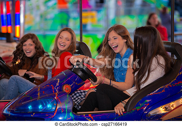 carnival bumper ride group of teens - csp27166419