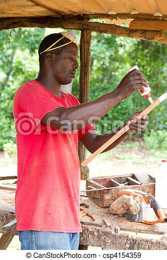 Carpenter Applying Glue - csp4154359