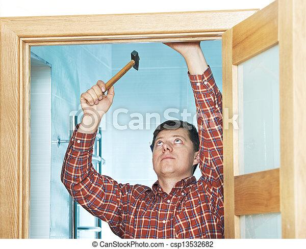 carpenter at door installation - csp13532682