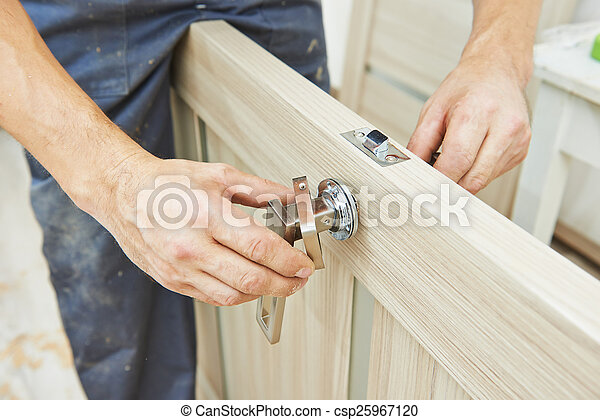 carpenter at door lock installation - csp25967120