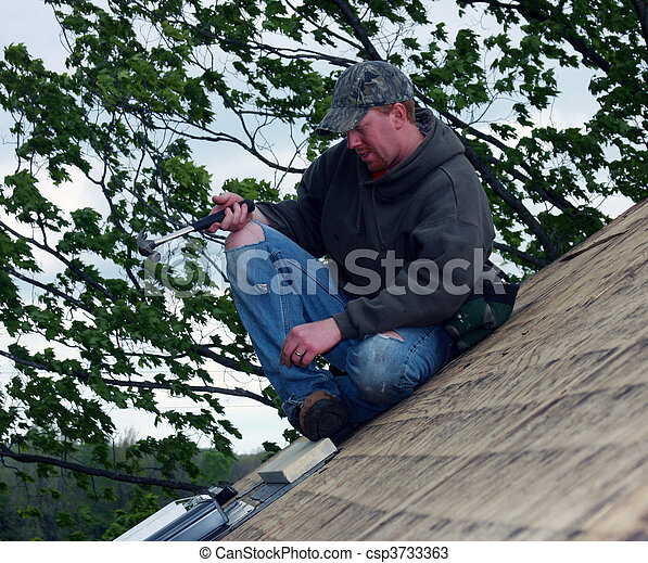 carpenter on a house roof - csp3733363