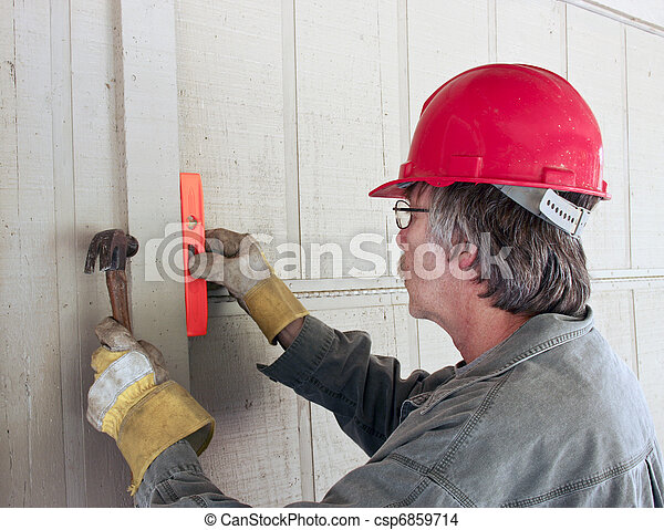 carpenter working construction - csp6859714