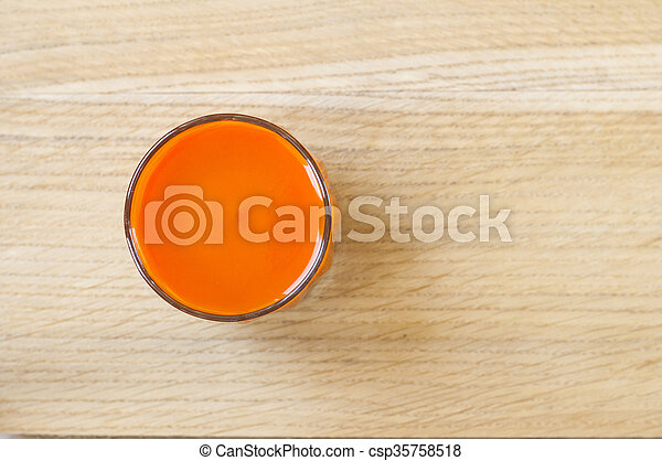 Carrot juice in glass. - csp35758518