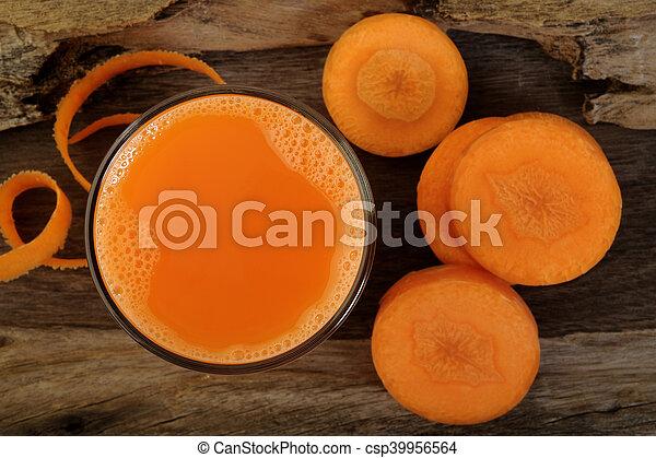 Carrot juice in glass - csp39956564