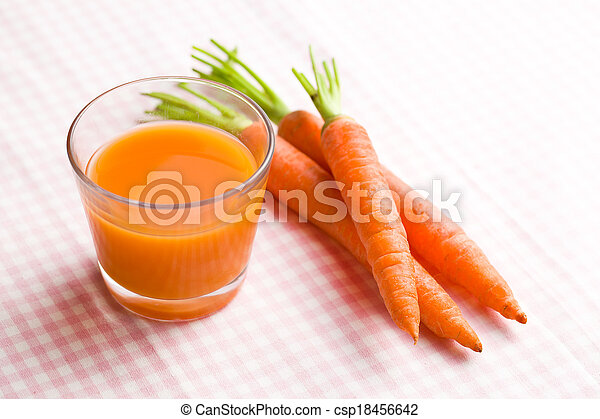 carrot juice in glass - csp18456642