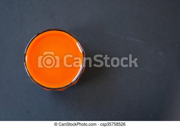 Carrot juice in glass. - csp35758526