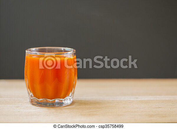 Carrot juice in glass. - csp35758499