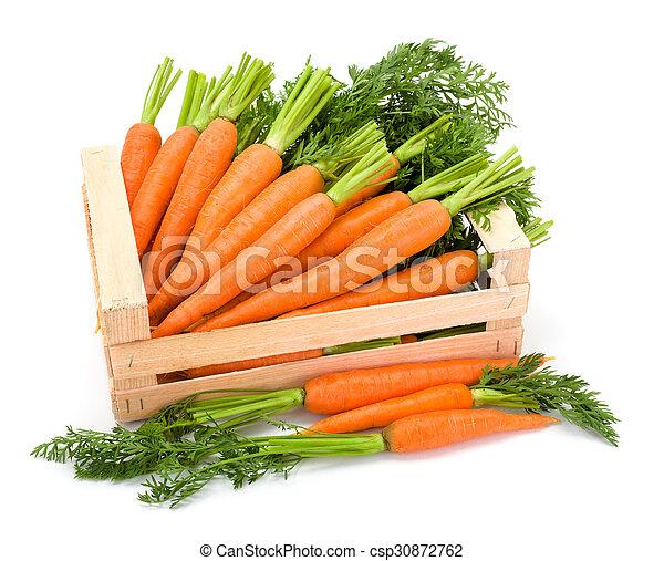 Carrot roots (Daucus carota ssp. sativus) in wooden crate - csp30872762