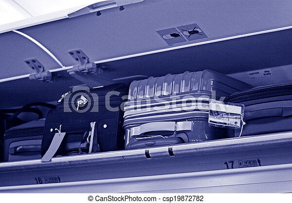 Carry-on and Overhead Baggage - csp19872782