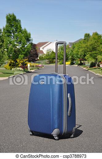 Carry on Luggage in Neighborhood - csp3788973