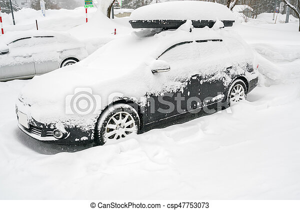 Cars covered with white snow in winter