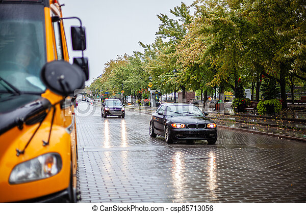 Cars driving on the rainy road - csp85713056