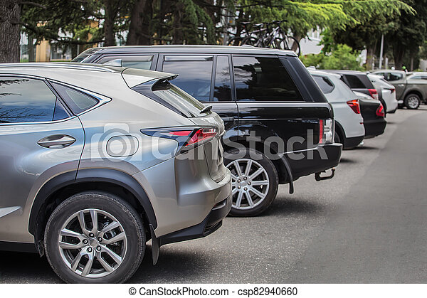 Cars in the parking lot along the street - csp82940660