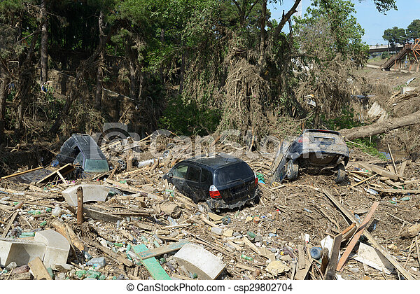 cars lay in  debris after  flood disaster - csp29802704