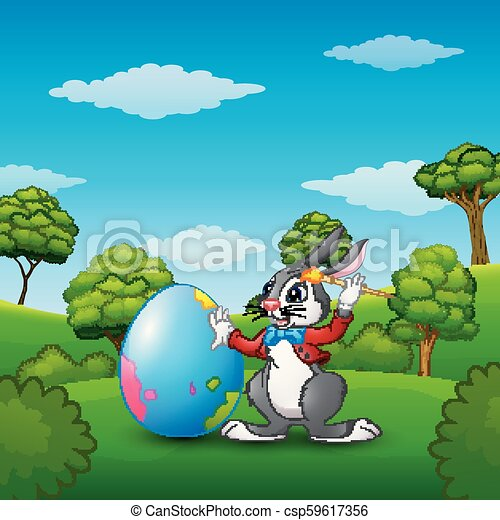 Cartoon Easter bunny painting Easter eggs in the park - csp59617356