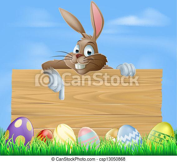 Cartoon Easter bunny pointing - csp13050868