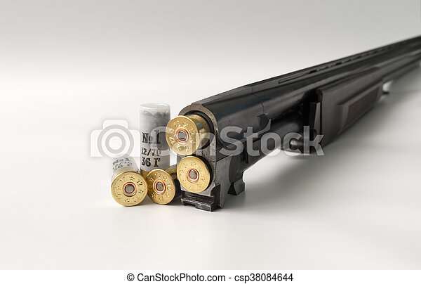 cartridges 12 gauge lying on a light background in close up view side - csp38084644