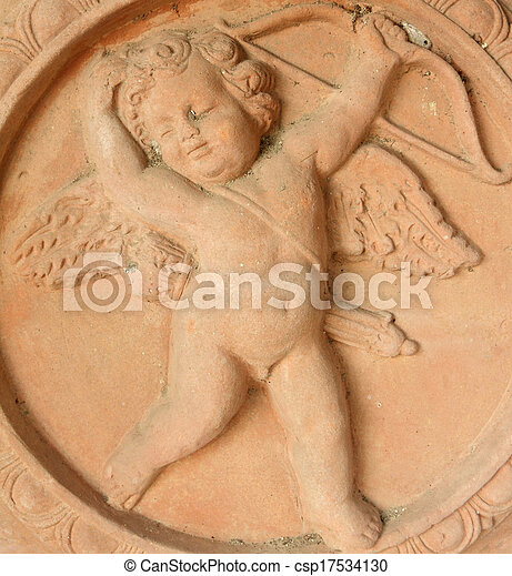 carved cupid with arrow and bow in tuscan terracotta  - csp17534130