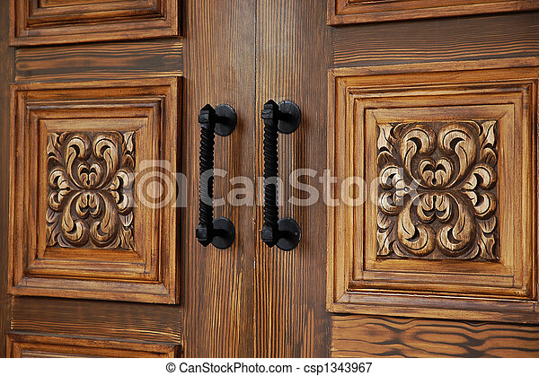 Carved Double Doors - csp1343967 & Carved double doors. Close-up detail on carved exterior... picture ...