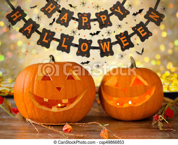 carved pumpkins and happy halloween garland - csp49866853