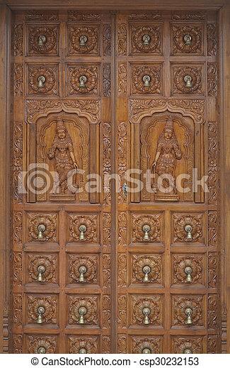 Carved wood hindu temple door. traditional hindu wood carvings on