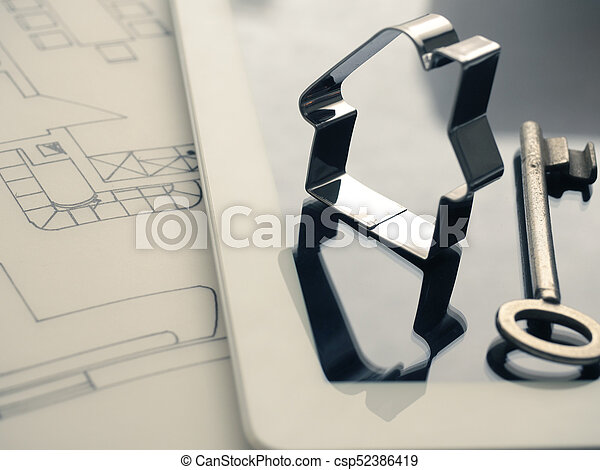 Forma de casa con una clave en el plan de construcción - csp52386419