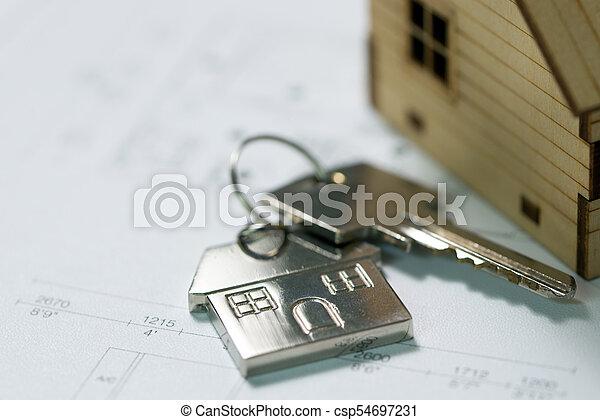 Llave con el plan de la casa - csp54697231