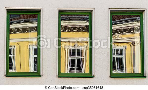 La casa renovada se refleja en la ventana - csp35981648