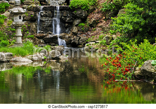 Cascading waterfall and pond - csp1273817