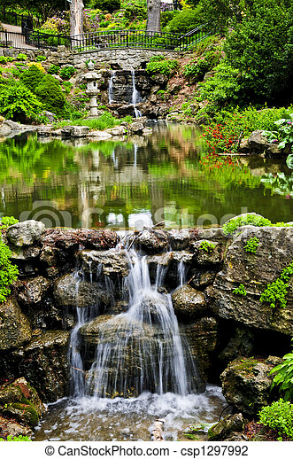 Cascading waterfall and pond - csp1297992